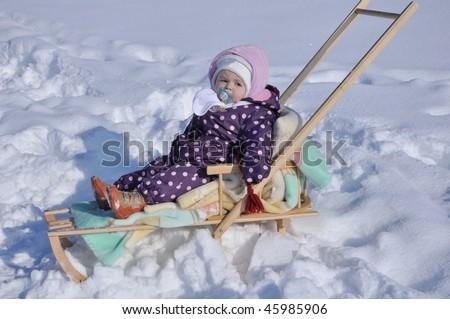 happy little girl on sledge - stock photo