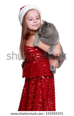 happy little girl with her new cat isolated on Holiday theme/Lovely girl and British cat on Christmas theme - stock photo
