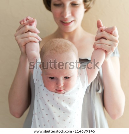 Happy Mother with her newborn baby - stock photo