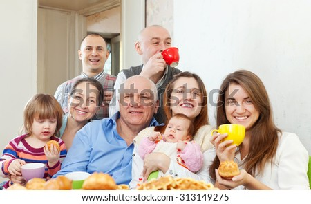 happy multigeneration family communicate over tea at home - stock photo