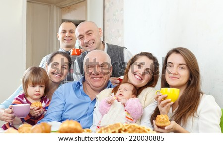 happy multigeneration family  drinks tea with baked  - stock photo