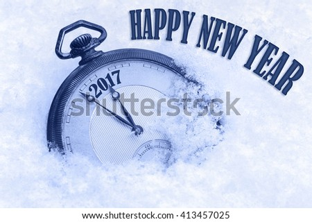 2017 Happy New Year, New Year 2017 greeting card, pocket watch in snow, English text