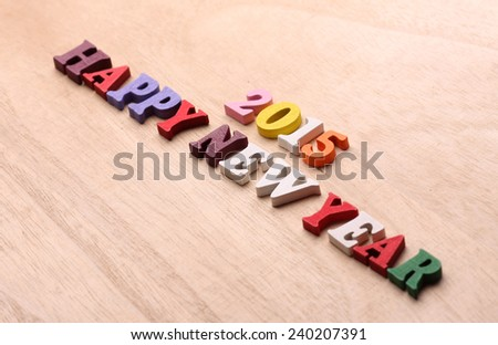 2015 happy new year on wooden background - stock photo