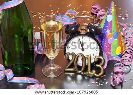 2013 happy new year party with clock champagne and hat on table - stock photo