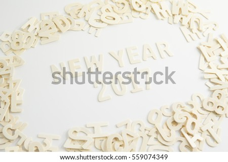 2017 Happy New Year wooden textured wording isolated on white background.
