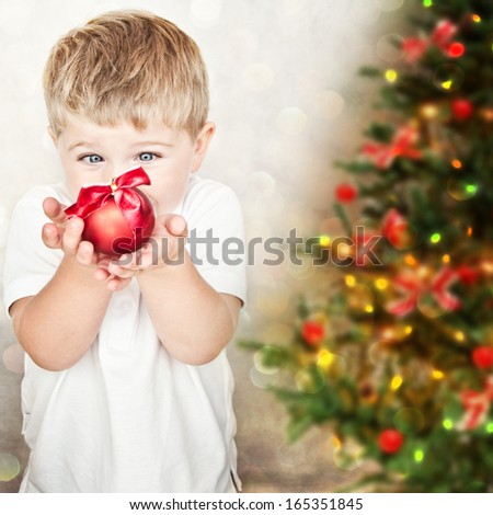 Happy small boy with christmas ball - stock photo