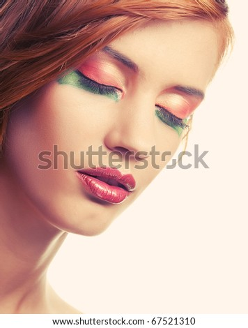 Happy smiling redhaired woman with creative makeup - stock photo