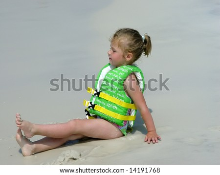 Happy toddler girl on the beach - stock photo