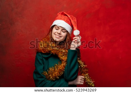 Happy woman celebrates new year. Christmas joy and a smile