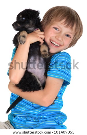 Happy young boy with pet dog - stock photo
