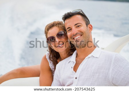 happy young couple on their yacht enjoying the summertime - stock photo