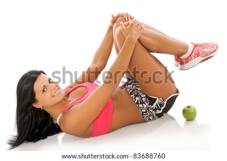 Happy young fitness woman  during workout. - stock photo