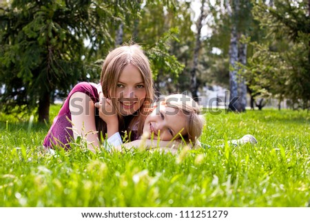 happy young mother with her daughter have a rest one nature