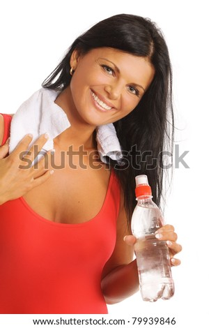 Happy young woman with bottle of water over white - stock photo
