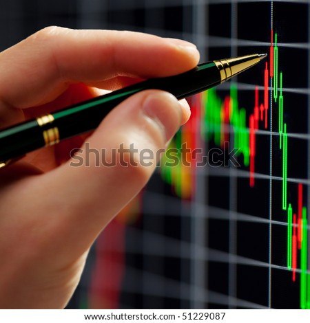 ?hart on computer monitor, market's climbing, hand and pen pointer - stock photo