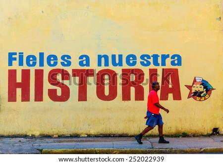HAVANA, CUBA - DECEMBER 2, 2013: Graffiti and wall paintings presenting remnants of the Cuban Communist Revolution, Havana, Cuba - stock photo