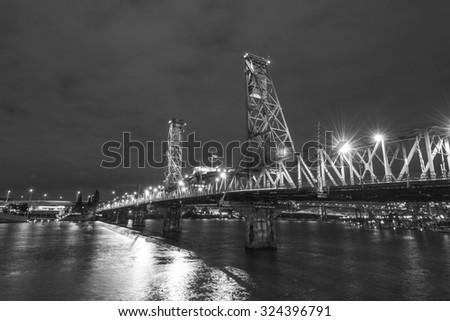 Hawthorne Bridge,take in Portland Oregon downtown waterfront city skyline along Willamette River. - stock photo