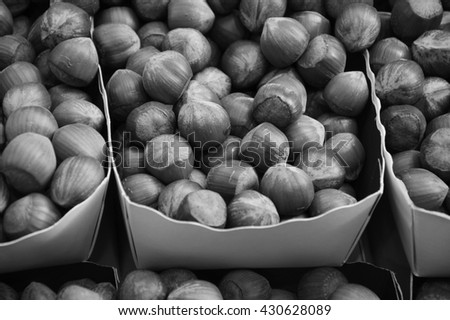 Hazelnuts for sale at local farmers market. Black and white photo. - stock photo