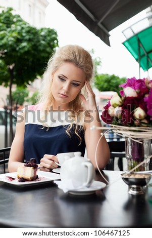 Headache -portrait of woman in pain outdoor - urban setting - stock photo