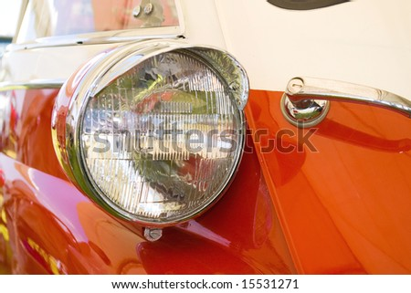 headlight in red white italian vintage car - stock photo