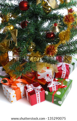 heap of  gift boxes  under decorated Christmas tree - stock photo