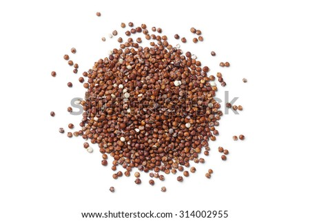 Heap of red raw Quinoa seeds on white background