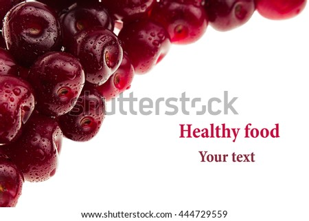 Heap of ripe cherries with water drops on a white background. Decorative frame of fruits. Isolated. Macro. Food background. Copy space. - stock photo