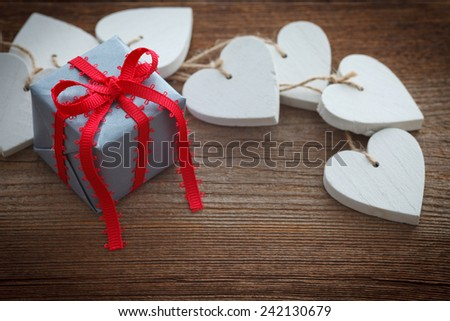 hearts and gift on wooden board for valentines day - stock photo