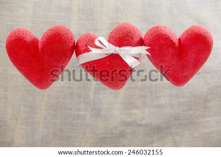 3 hearts red, background, Cream - stock photo