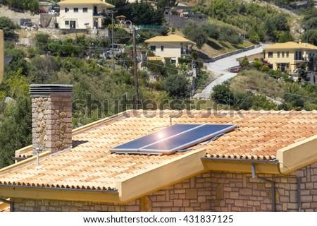 heater solar roof, renewable energy - stock photo