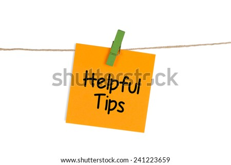 """Helpful Tips"" written on Sticky Note - stock photo"