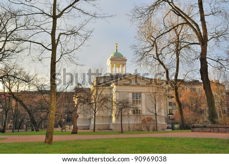 Helsinki.  Orthodox Old church hidden among the trees in the park