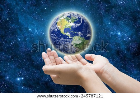 her hand a glowing earth globe, Elements of this image furnished by NASA  - stock photo