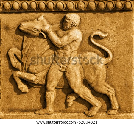 Hercules and the Bull in sand stone - stock photo
