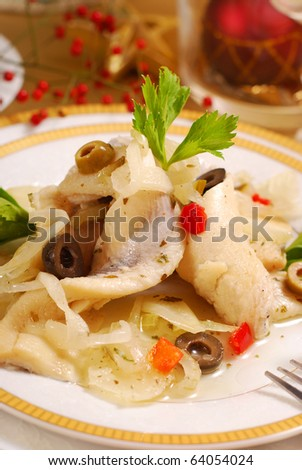 herring salad  with olives  and onion for christmas - stock photo