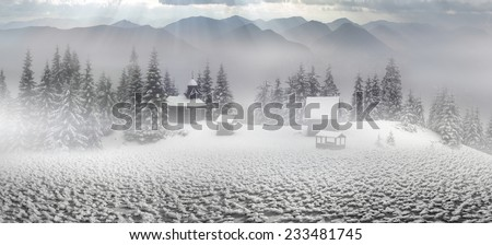 High in the mountains is an ancient small wooden temple where the summer come to pray herders of sheep, cows and horses, and in winter the wind and cold among the huge expanses - stock photo