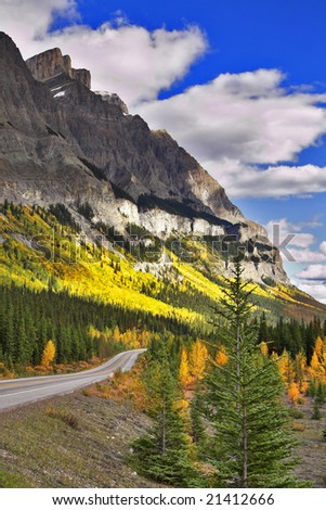 Highway in the north of Canada in mountains - stock photo