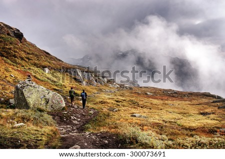 Hiking group  in mountains. Norway  - stock photo