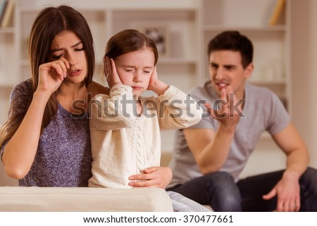 Ð¡hild can not listen quarrel of parents, it is difficult for the child's mind.They are at home - stock photo