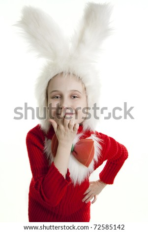 ?hild in a white downy bunny costume. - stock photo
