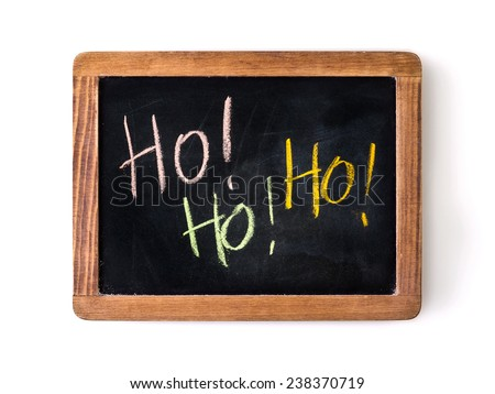 'Ho, ho, ho!' (such as the expression of Santa Claus) written with colored chalks on a blackboard. - stock photo