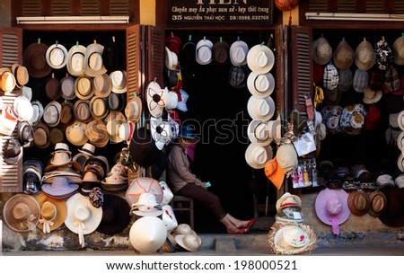 HOI AN, VIETNAM- MAY 15: Abstract hat shop show many kind of hat at front of ancient wooden house of antique market, Hoian is famous place for travel, Viet Nam, May 15, 2012     - stock photo
