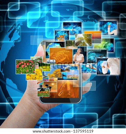 holding mobile smart phone with world technology background - stock photo