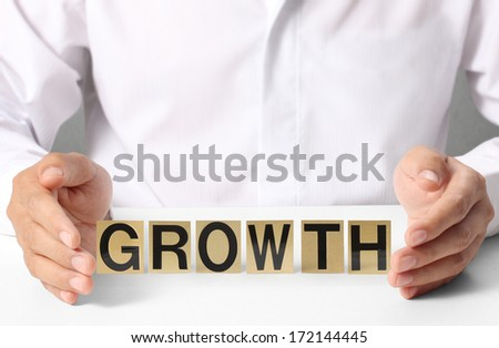 Holding word growth in hand - stock photo