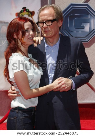 "19/7/2009 - Hollywood - Kelli Garner and Bill Nighy at the Disney World Premiere of ""G-Force"" held at the El Capitan Theater in Hollywood, United States.  - stock photo"