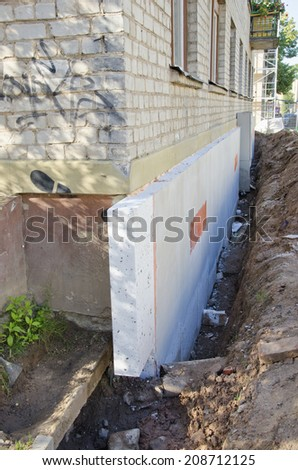 home foundation  concrete construction and thermal insulation material styrofoam - stock photo