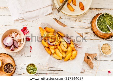 Homemade fried potatoes.The Perfect finger food for cottage fries potatoes and a delicious accompaniment to many a meal. - stock photo