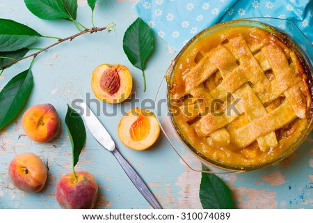 homemade peaches  pie  .top view.  style vintage. selective focus. - stock photo