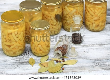 Homemade preserved yellow beans in spicy  pickle, spices bay leaf and black pepper