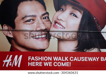 --HONG KONG  March 2015 :  Advertising of famous  shwedish company H & M. in Hong Kong .  H & M., Europe's largest retailer of clothing. Headquartered in Stockholm, Sweden. - stock photo